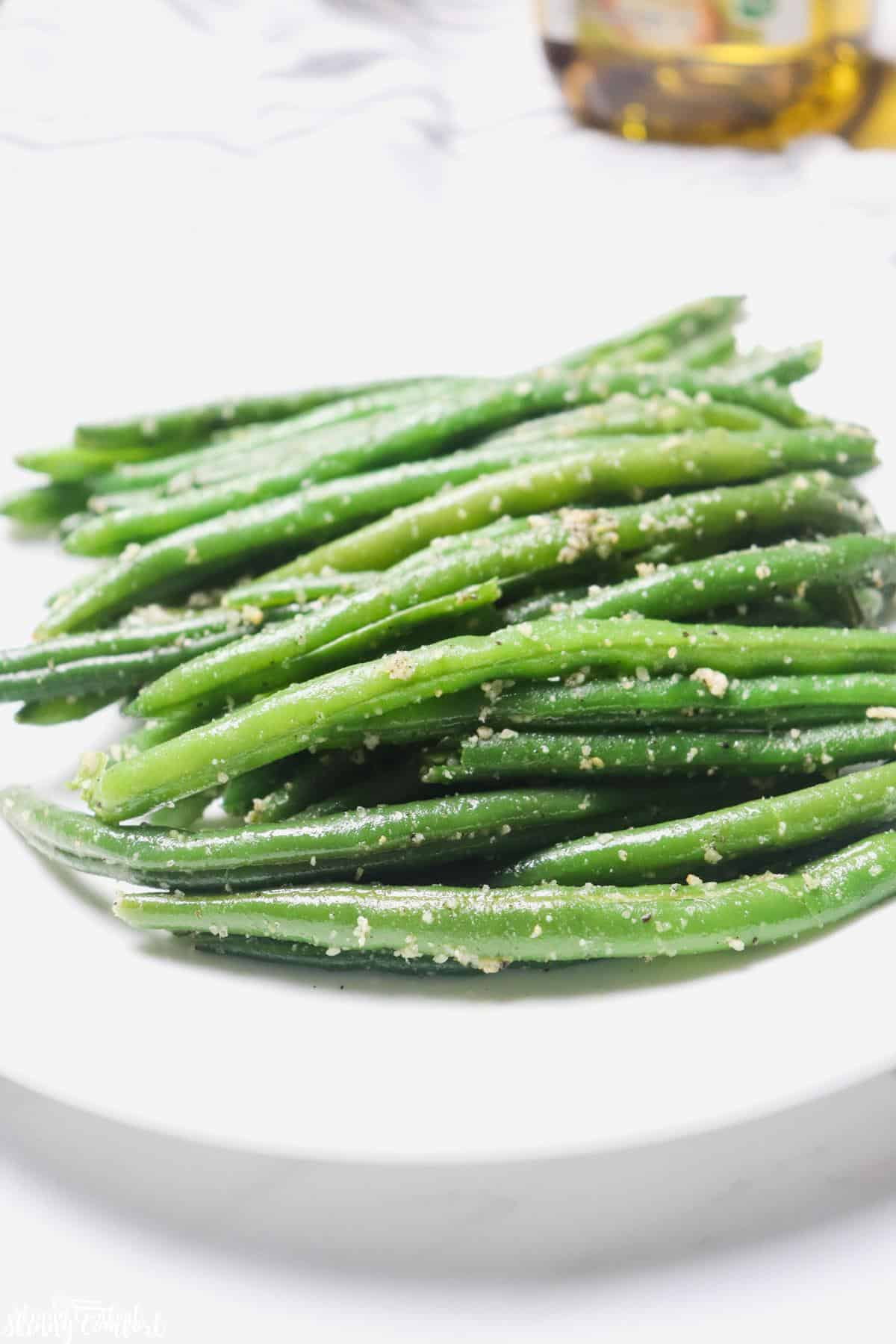 Cooked garlic Parmesan green beans on plate