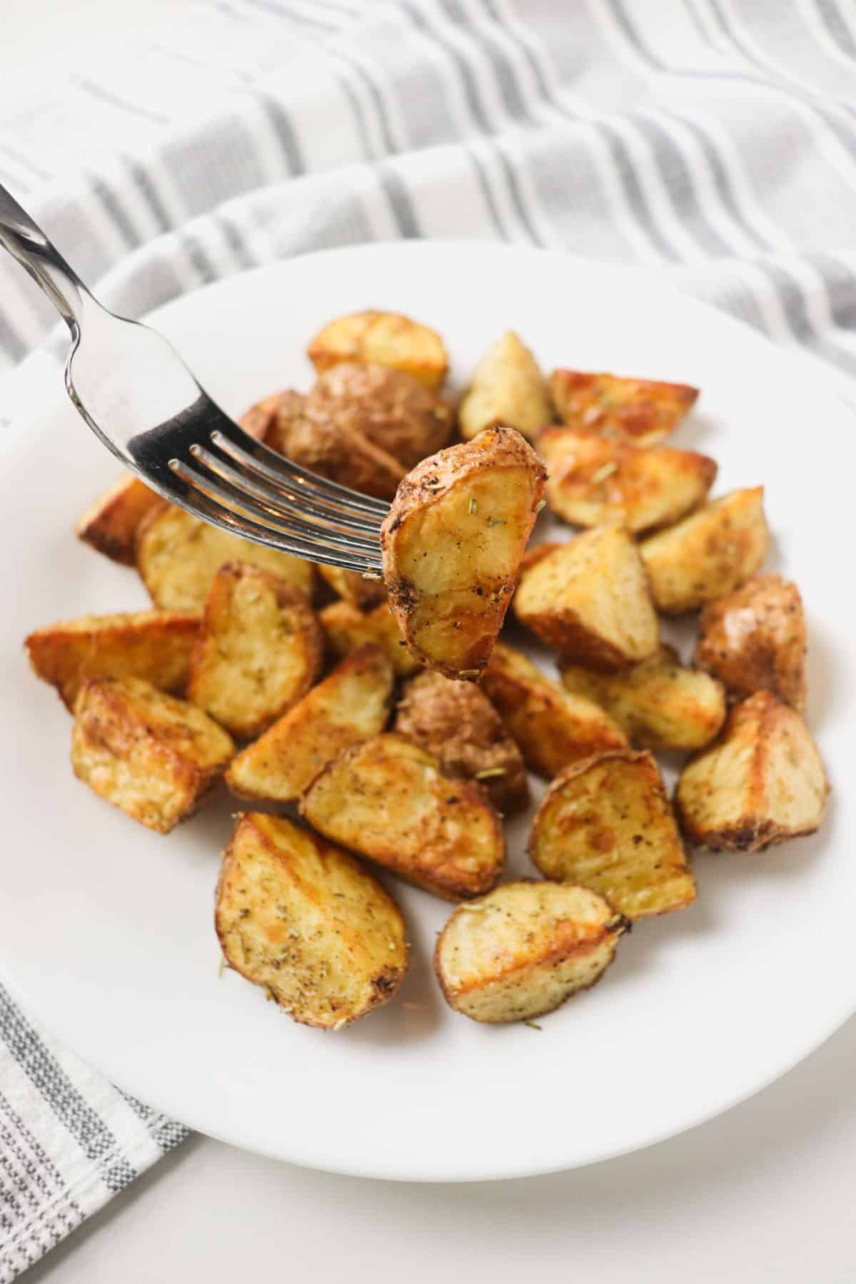air fryer roasted potato piece on fork