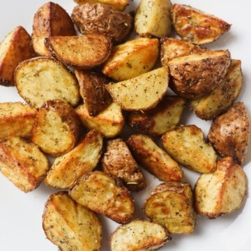roasted potato pieces on white plate