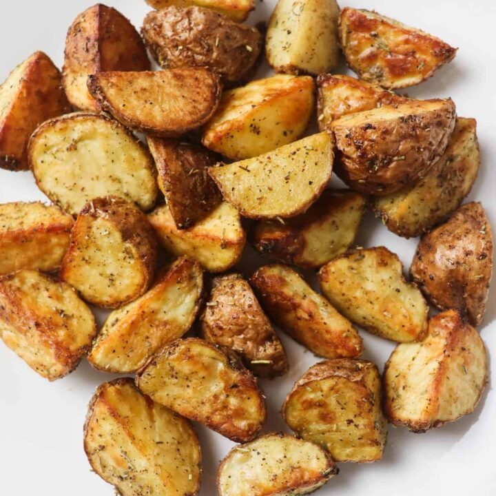 roasted potato pieces on white plate