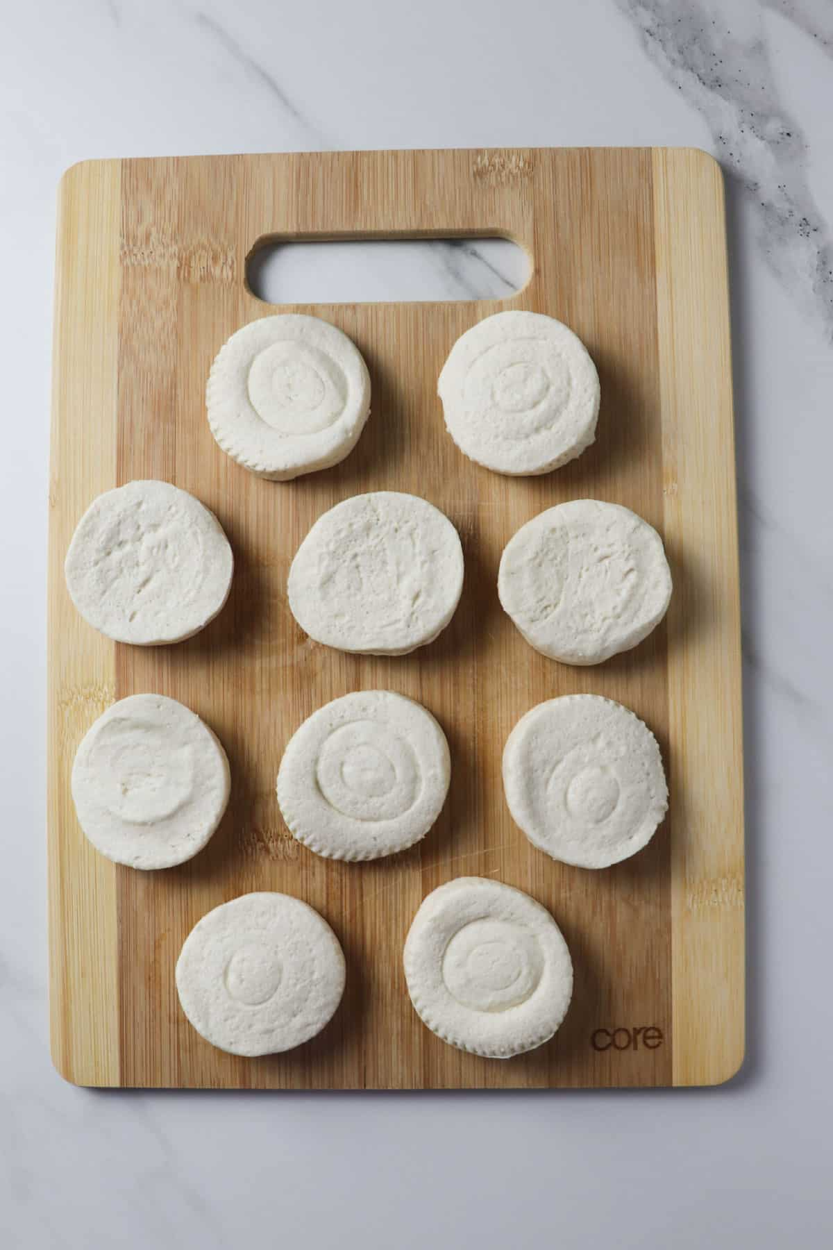 biscuits laid out on wooden cutting board