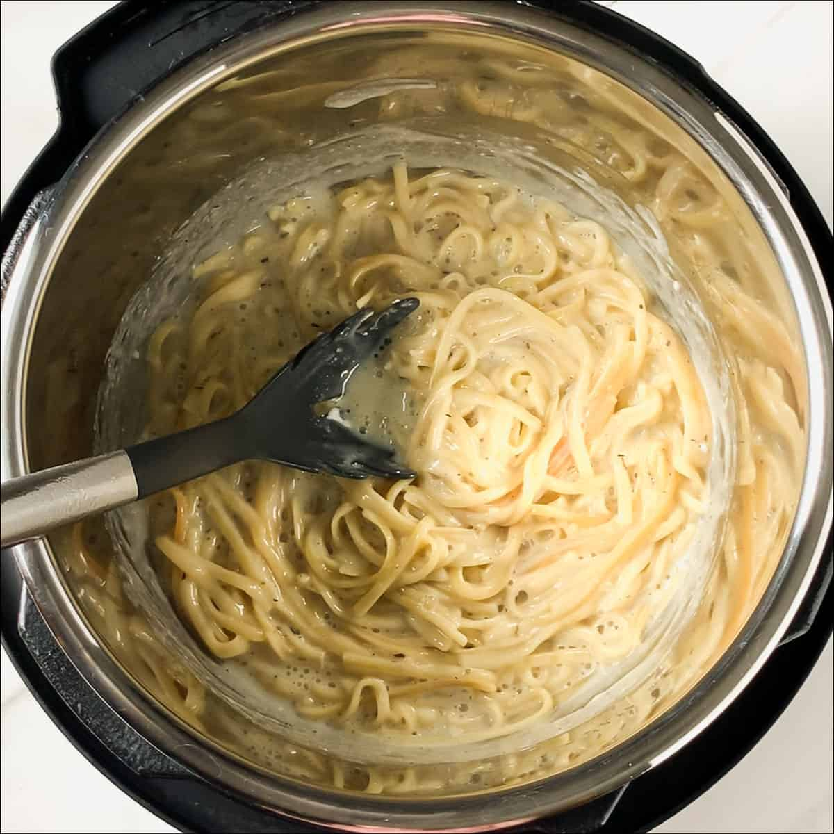 cream cheese mixed into alfredo sauce in instant pot