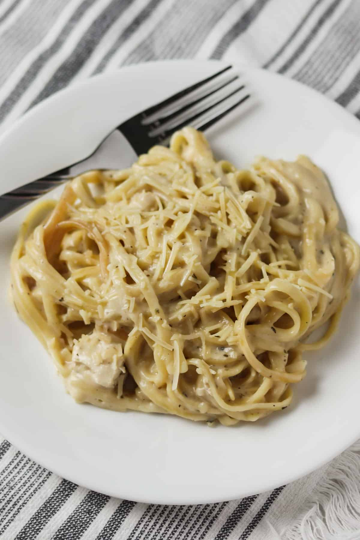 chicken alfredo on plate with fork