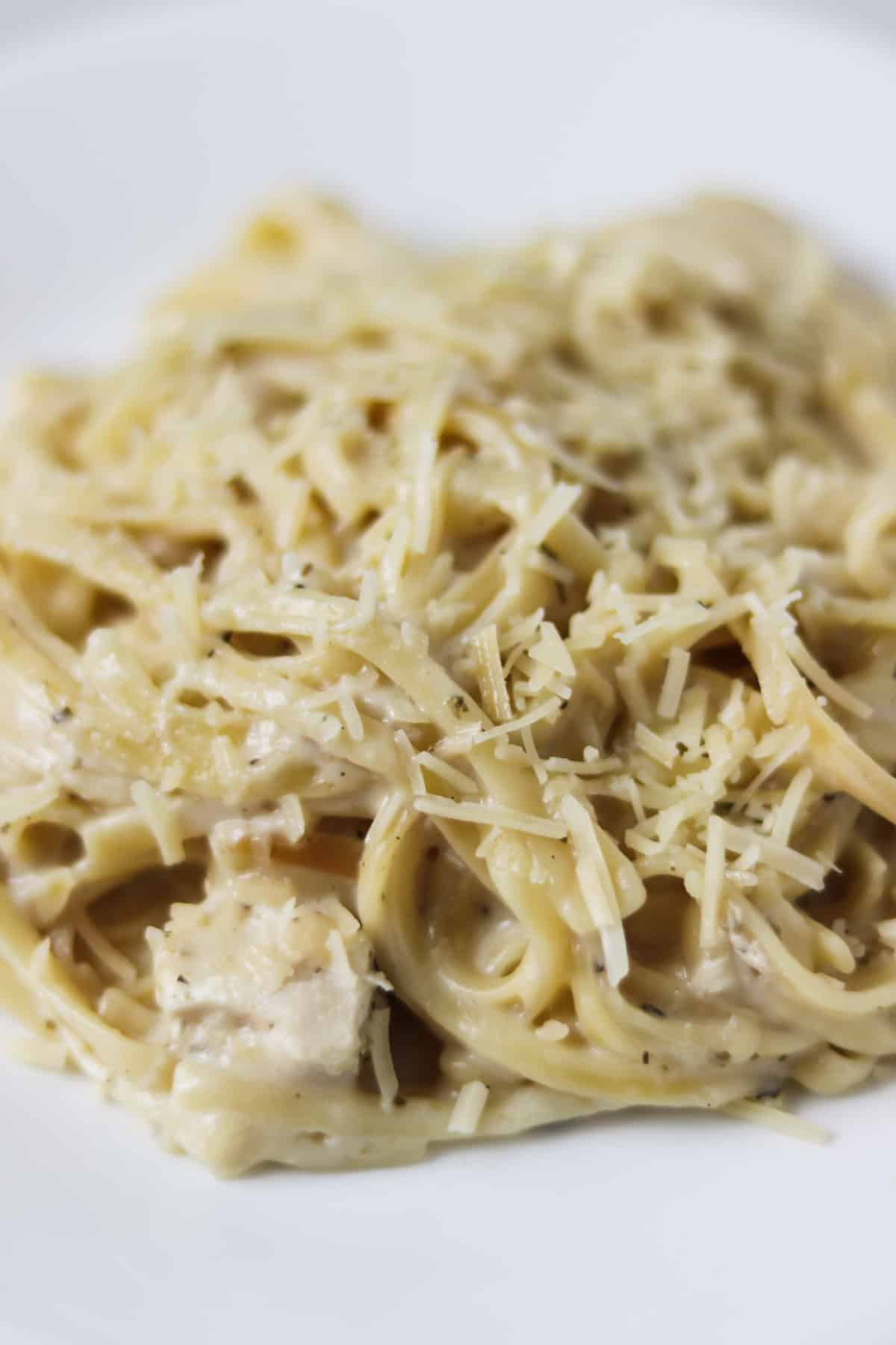 instant pot chicken alfredo on plate with parmesan cheese on top