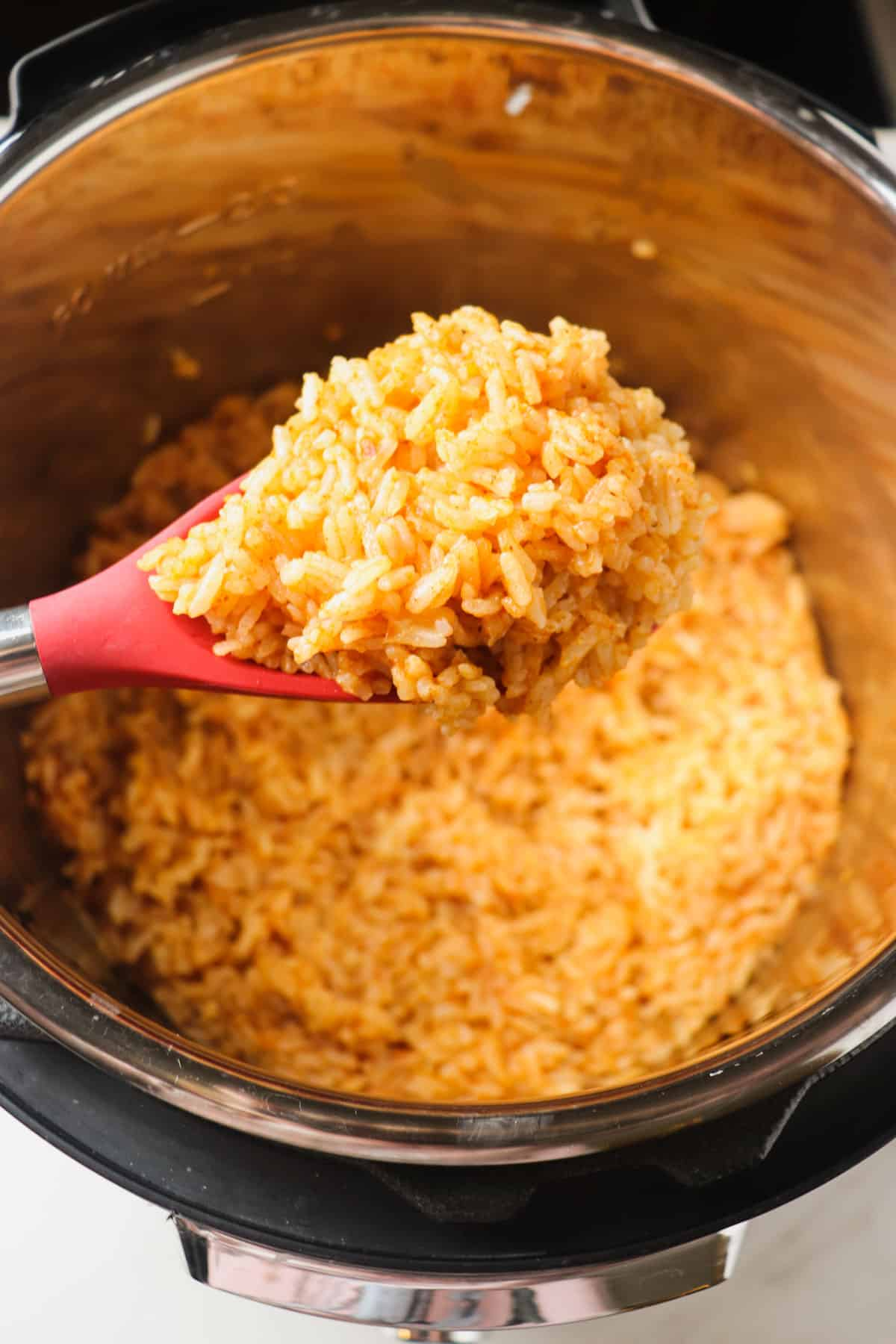 scooping out a spoonful of mexican rice from the instant pot