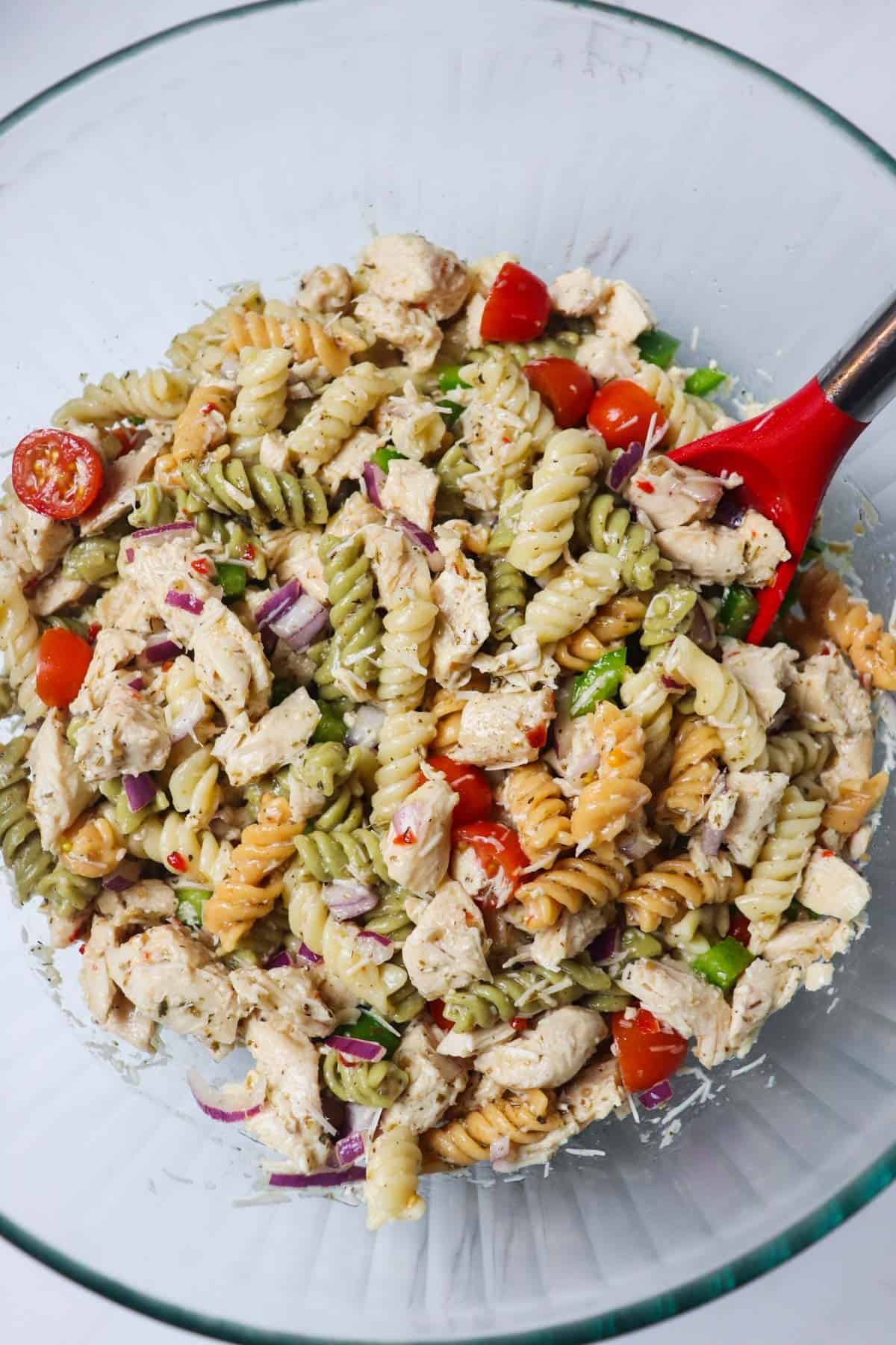 finished italian chicken pasta salad in large glass bowl