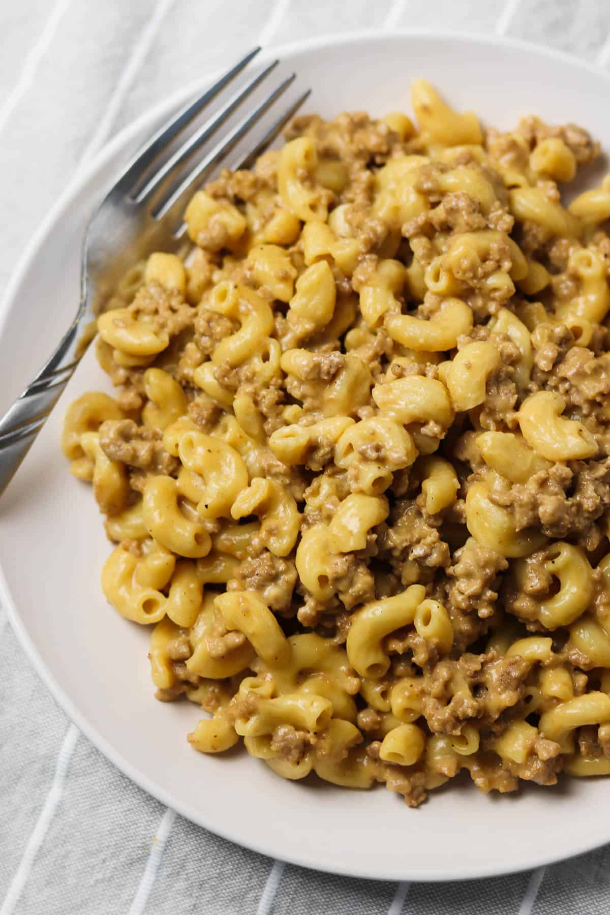 instant pot hamburger helper on white plate with fork