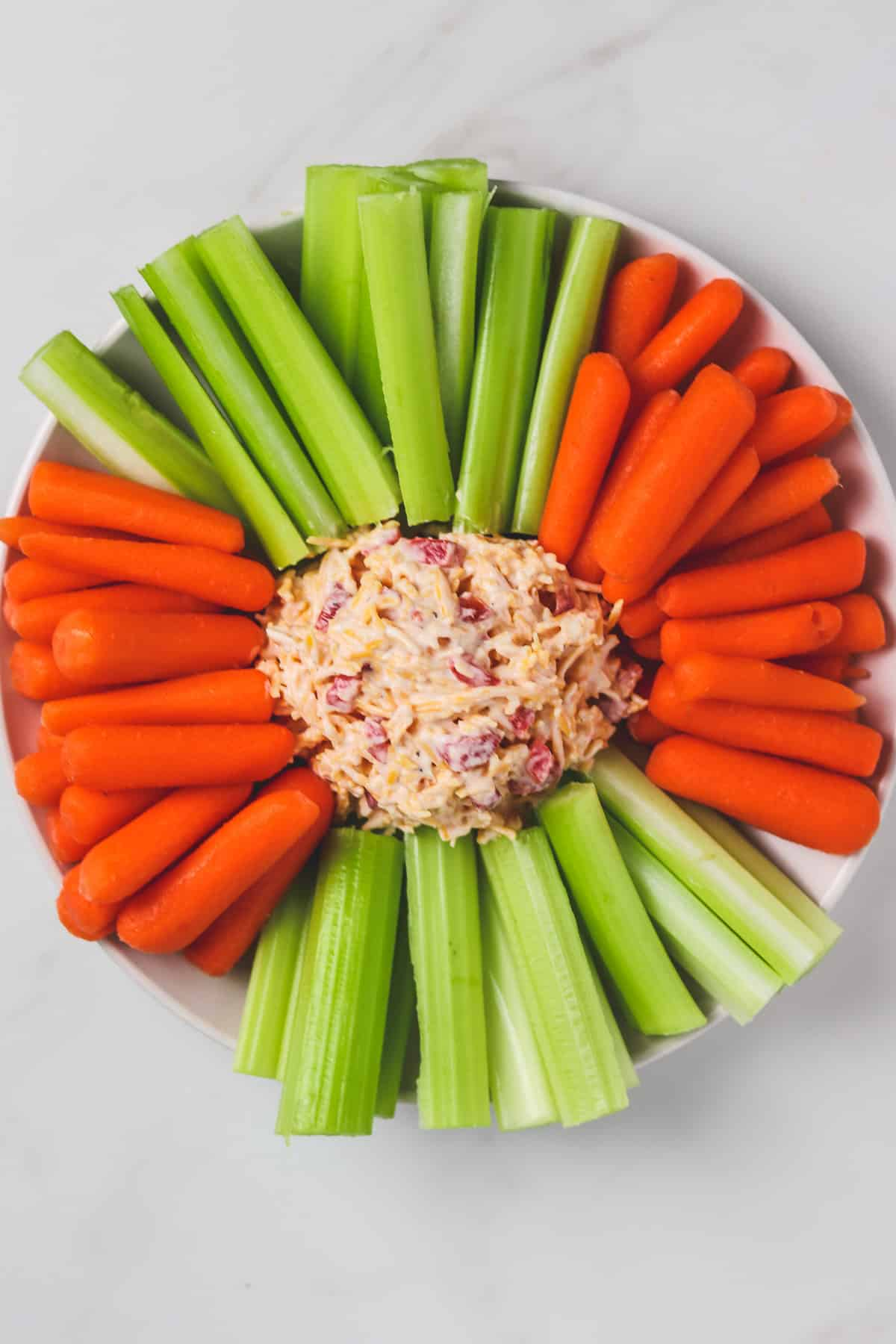 top down view of platter with pimento cheese, carrots, and celery