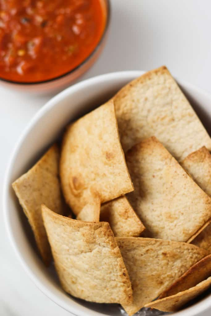 air fried low carb tortilla chips in a bowl with salsa