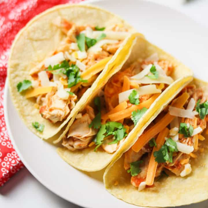 instant pot shredded chicken tacos on white plate