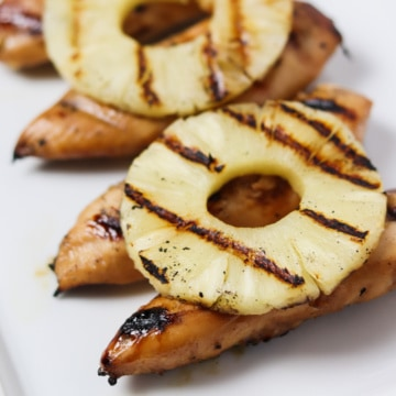 grilled chicken tenders with pineapple on top