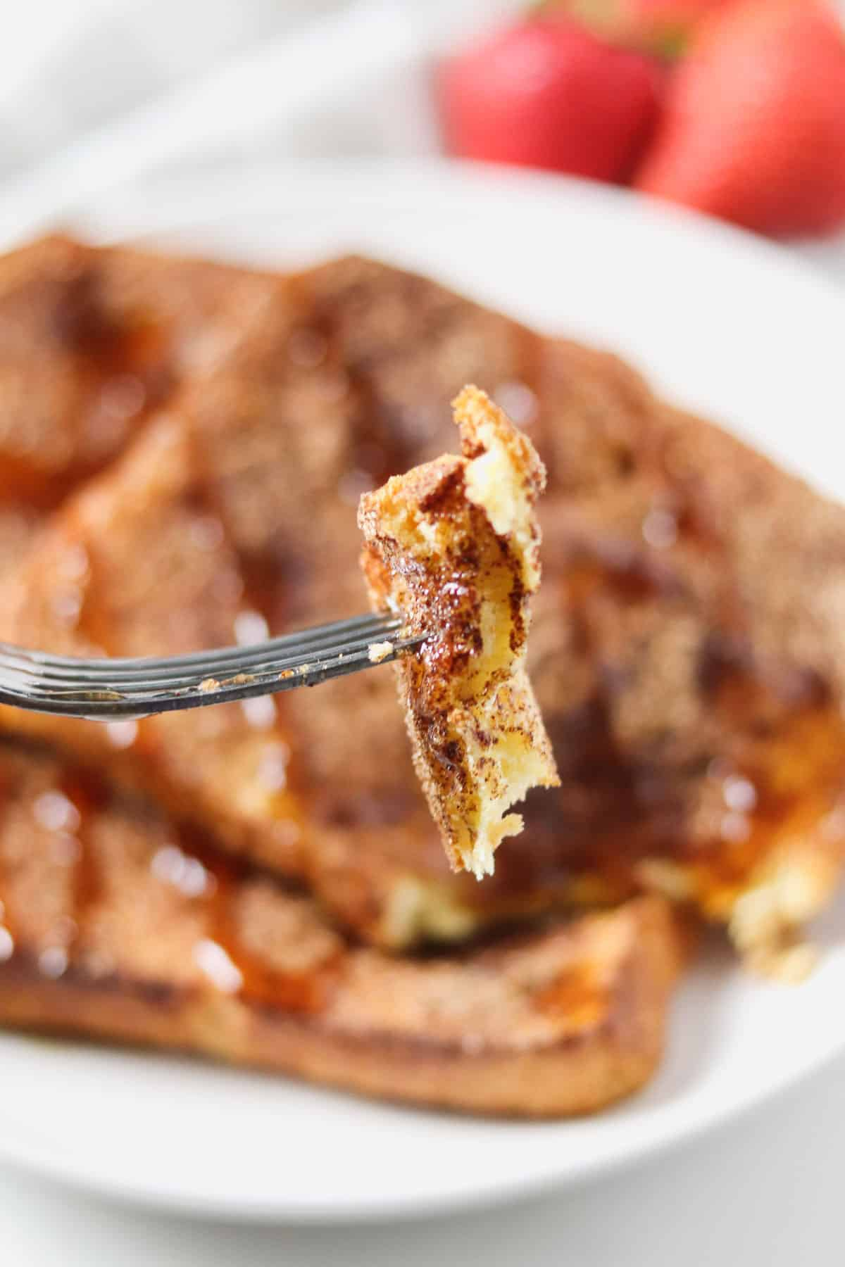 taking a bite of air fryer french toast