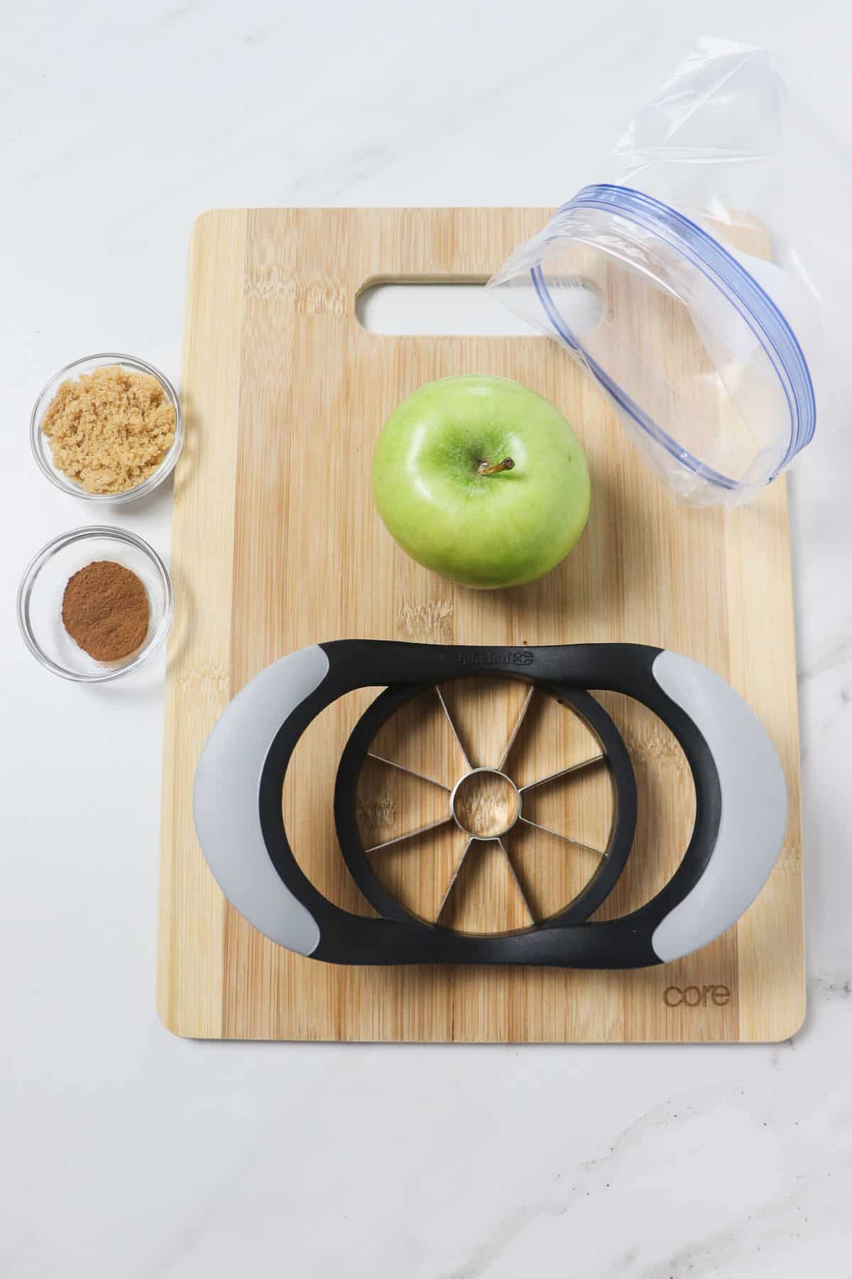 ingredients and tools for making cinnamon sugar apple slices