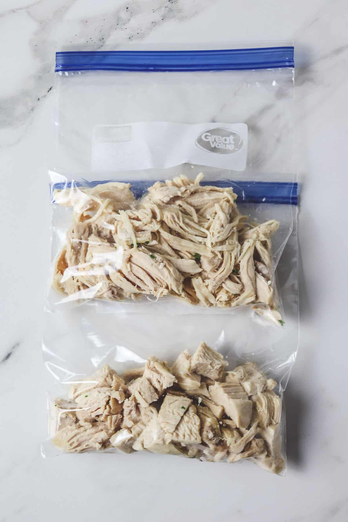 shredded and diced chicken in plastic bags ready to freeze