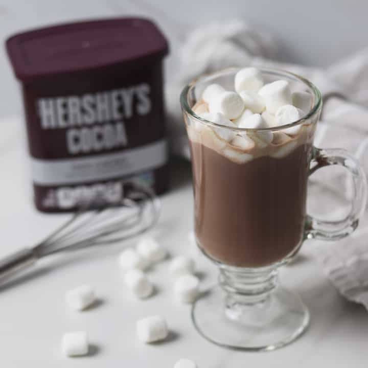sugar-free hot chocolate with marshmallows, whisk, and cocoa powder