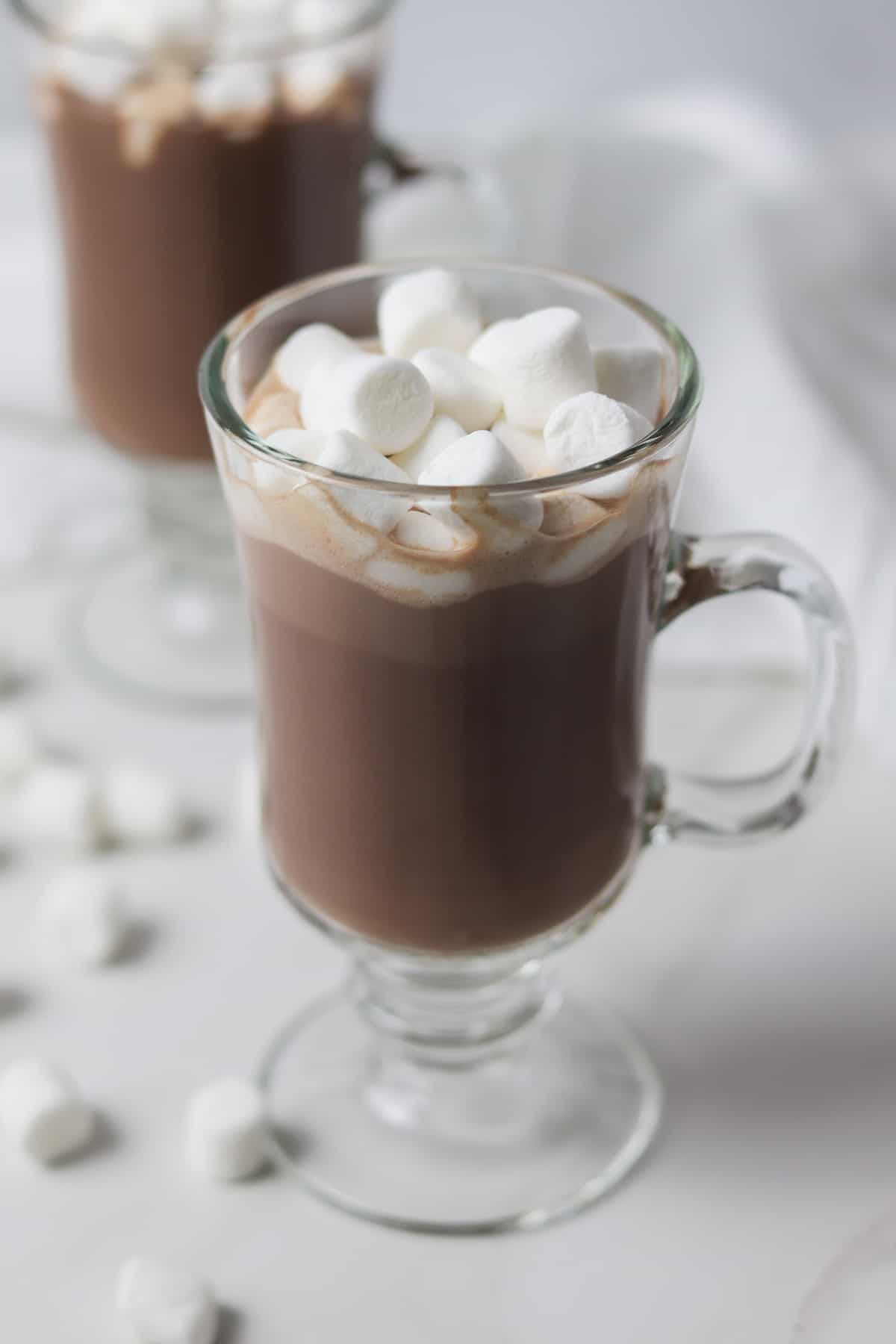 two cups of sugar-free hot chocolate topped with marshmallows
