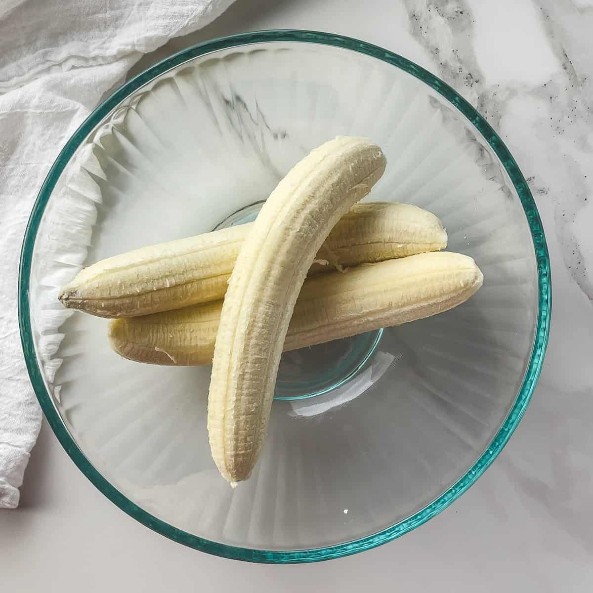 whole peeled bananas in a mixing bowl