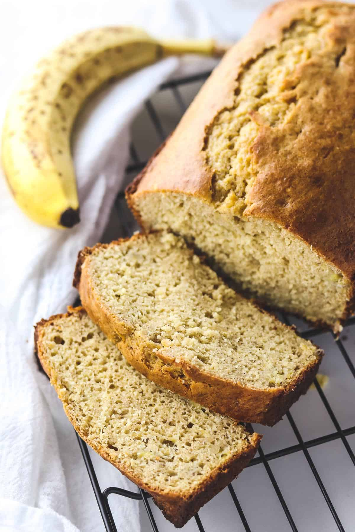 low calorie banana bread sliced on a cooling rack