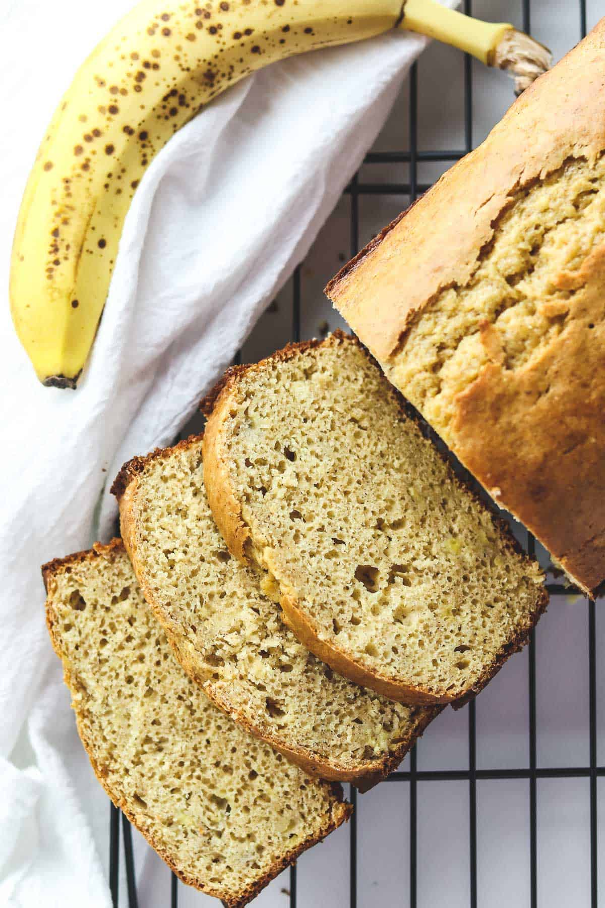 low calorie banana bread cut into slices on a coolign rack