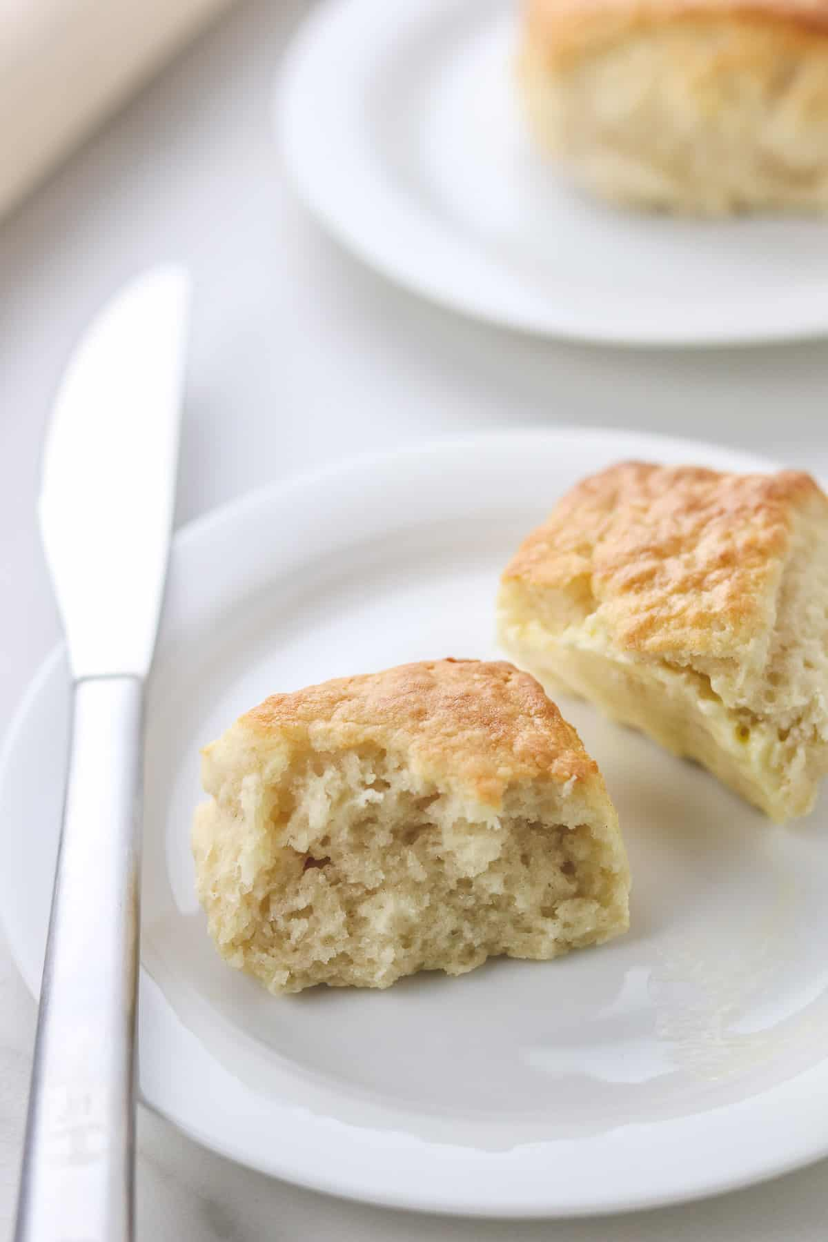low calorie biscuit cut in half on a white plate