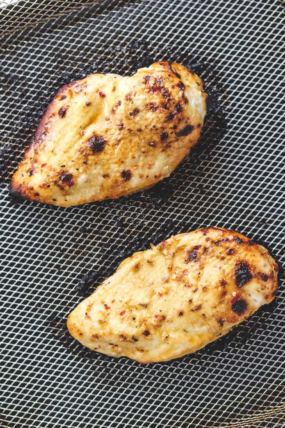 Italian chicken breasts in air fryer basket