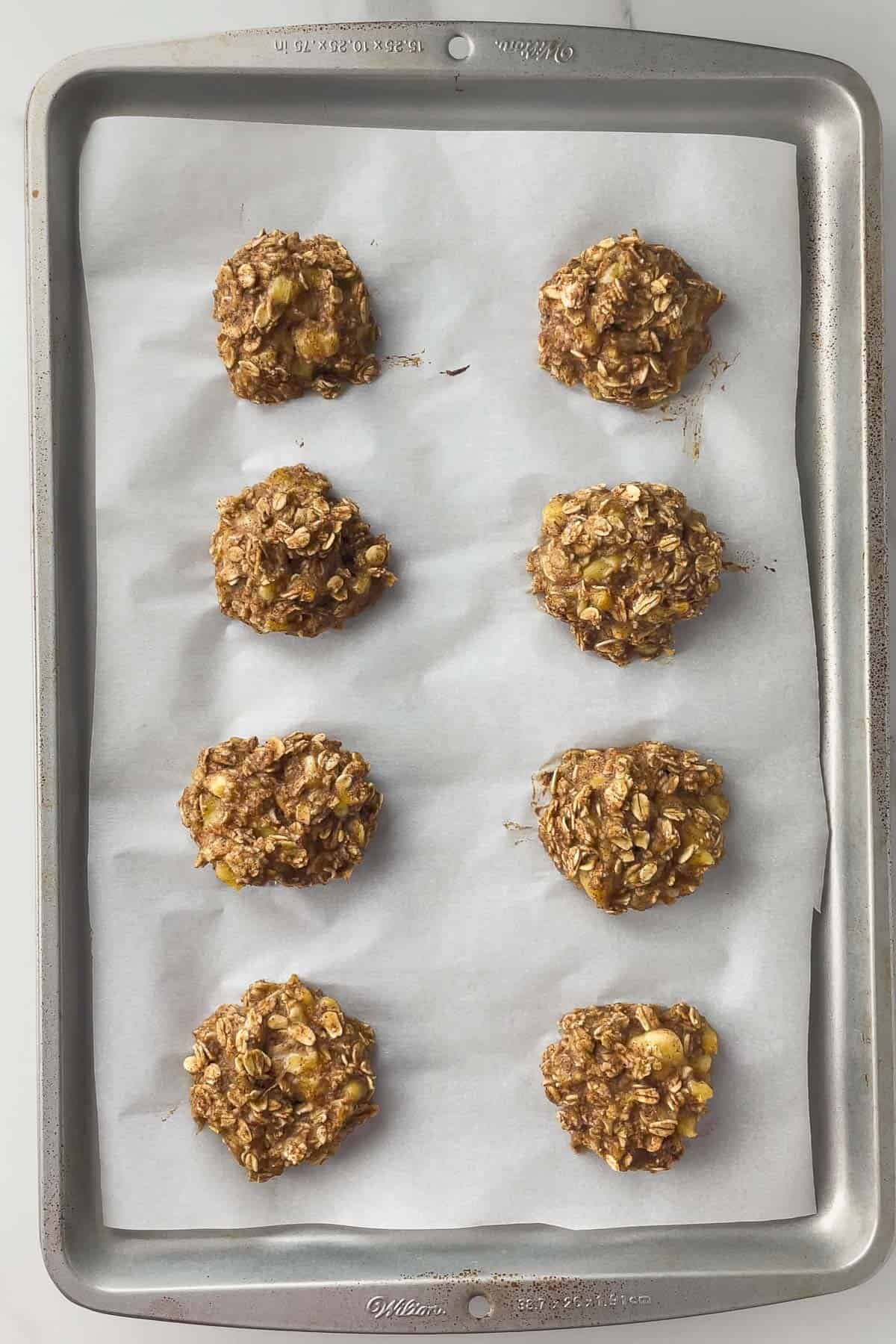 banana oatmeal cookies on a baking sheet