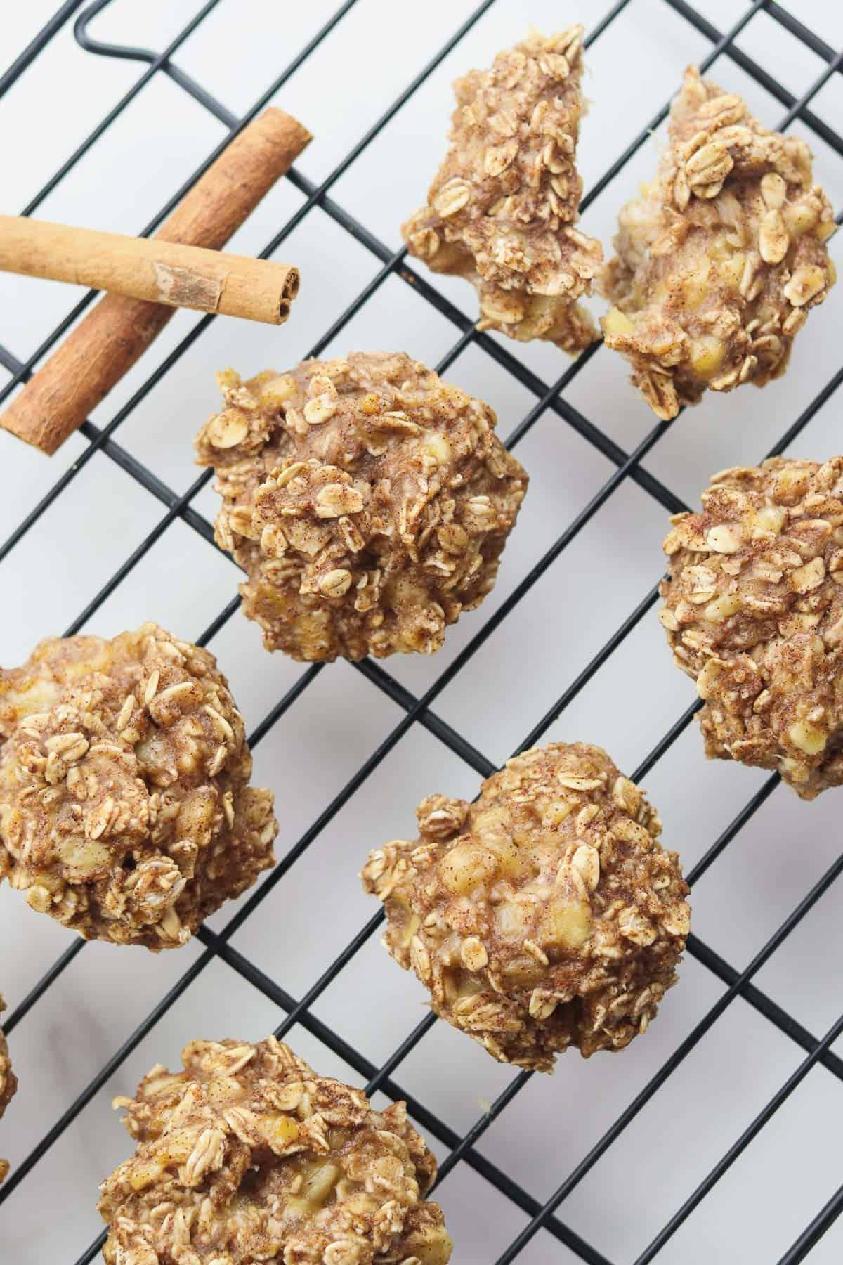 banana oat cookies on cooling rack with cinnamon sticks