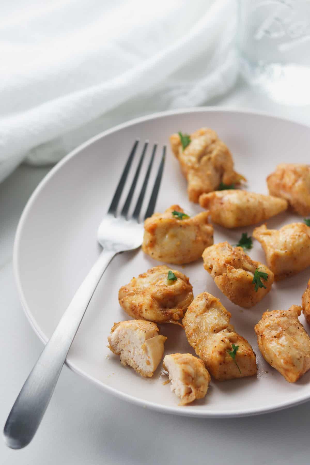 plate of air fryer rotisserie chicken bites