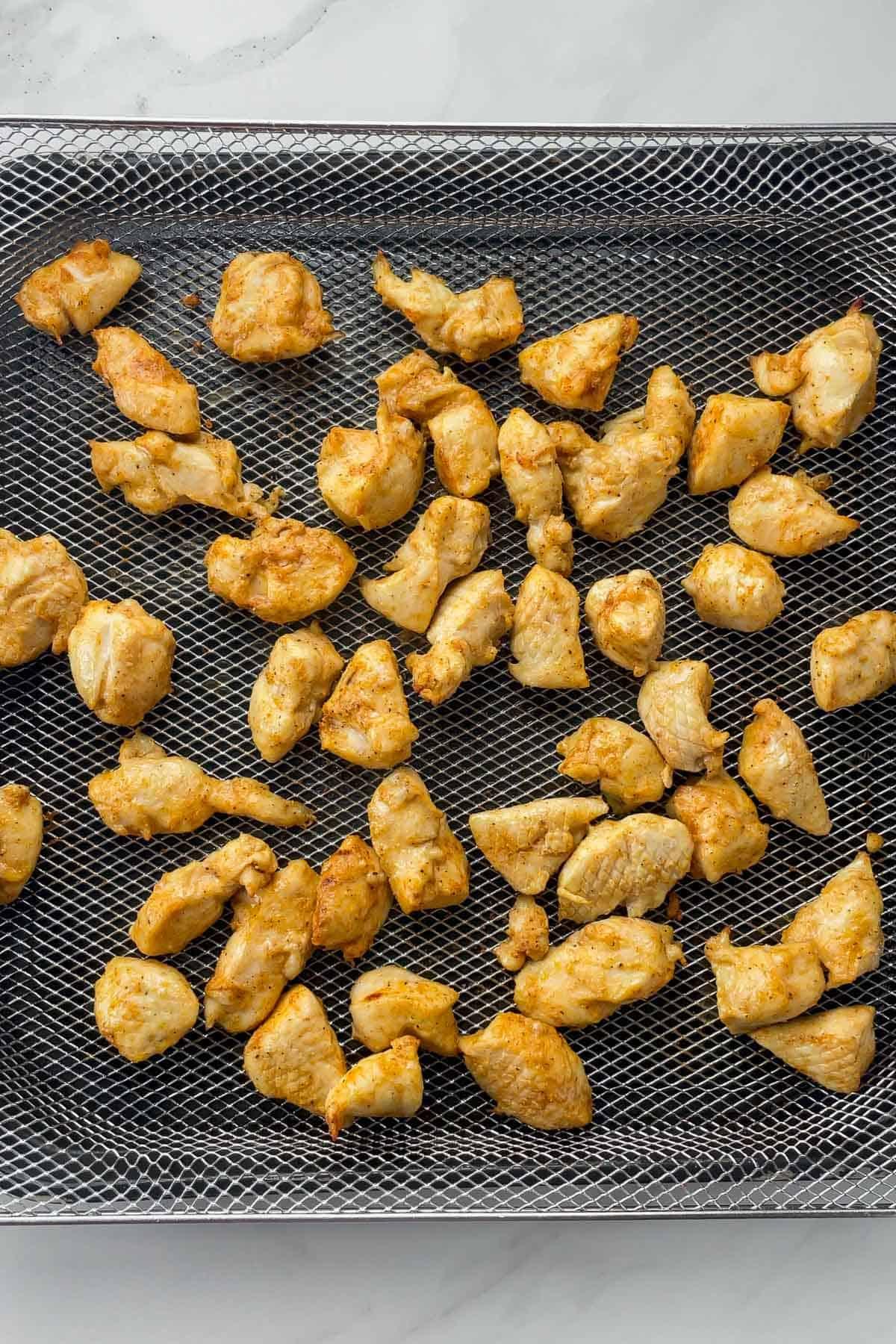 cooked rotisserie chicken bites in air fryer basket